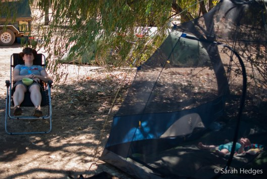 Rachel chills in my camp chair while Brynie chills in the tent.  The Hilleberg tent and bikes that you can just make out through the tree belong to an Australian/German couple who are cycling the Gibb River Road as the final stage in an 18-month long trip that started in Germany.  We enjoy chatting with them, and they give us lots of tips for good camping options along the way.