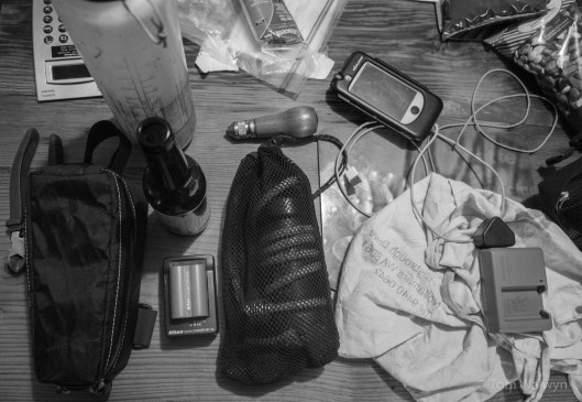 A bit of everything - all with a story.  The water filter has a new hose; the camera lens case; a waterproof iPhone case that allows charging; the Nikon DLSR battery for Sarah; and the edge of a bag of scroggin, plus many more.