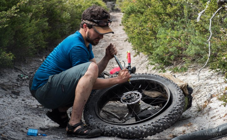 Scott working on the only puncture of the trip - the result of whoop-bombing down a steep rocky descent :-)
